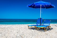 Ocean beach on the Crete. Ocean beach and sunbeds on the Crete in sunny day Royalty Free Stock Images