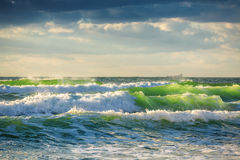 Ocean beach sunrise and big green waves Stock Photo