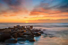 Ocean beach sunset. Stunning view on colorful ocean beach sunset stock images