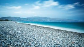 Ocean beach on the Crete long explosure. Ocean beach with turquoise water on the Crete long explosure Royalty Free Stock Images