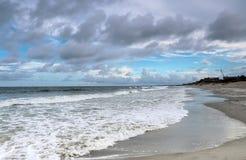 Ocean beach view. Landscape with cloudy blue sky over calm atlantic ocean. Atlantic ocean coast at Pawleys Island, Myrtle Beach area, South Carolina, USA Royalty Free Stock Images