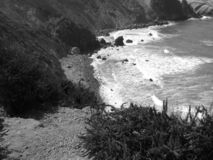 Ocean beach waves and rock. Picture in black and white of ocean beach waves and rock. Is made in America stock photos