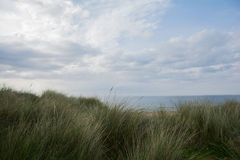 Ocean and the beach at wild atlantic way from behind the dunes Stock Images
