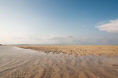 Ocean and beach with yellow sand - beautiful landscape Royalty Free Stock Photo