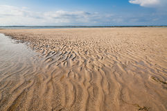 Ocean and beach with yellow sand Stock Photography