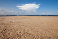 Ocean and beach with yellow sand and cloud in sky Royalty Free Stock Photos