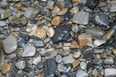 OCEAN BED OF STONES stock photo