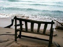 Ocean Benchmark. Old bench on a beach stock photos