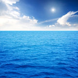 Ocean blue. Nice sky over blue ocean stock photos