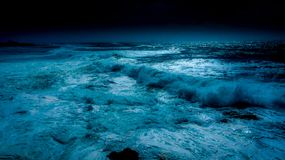 Ocean in blue moon night royalty free stock images