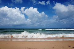 Ocean and blue sky. Active waves in the ocean and blue sky with white clouds Royalty Free Stock Photography