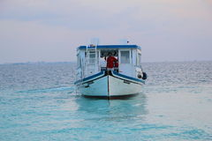 Ocean with boat. Maldives Stock Images