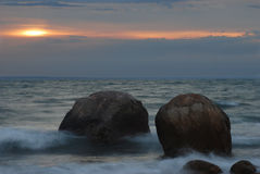 Ocean Boulders. Two large boulders loom off shore in the Atlantic ocean just after sunrise Royalty Free Stock Photography