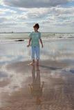 Ocean boy. Little boy walking by the ocean Stock Image