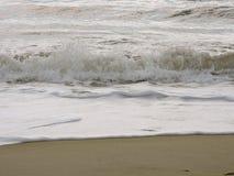 Ocean breaks on shore. Morning walk along the beach stock photos
