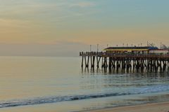 Calm Winter Evening at the Redondo Beach Pier, Los Angeles, California. The ocean is calm and still, the sky and water full of pastel hues in this image of the Royalty Free Stock Photography