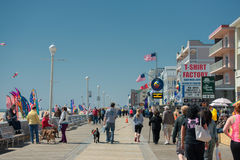 OCEAN CITY, USA - APRIL 24, 2014 - People walking the boardwalk in Maryland famous ocean city. OCEAN CITY, USA - APRIL 24, 2014 - People walking the boardwalk stock photography