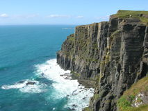 Ocean Cliff. A tall cliff overlooks the ocean on the west coast of Ireland. Near Cliffs of Moher, county Clare royalty free stock images