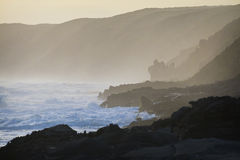 Ocean with Cliffs. The rocky coastline is smothered by a blanket of mist Royalty Free Stock Photography