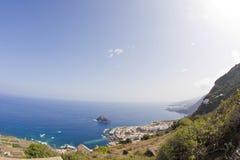 Ocean cliffs. Steep rocky volcanic cliffs near ocean Stock Photo