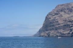 Ocean cliffs. Steep rocky volcanic cliffs near ocean Stock Images