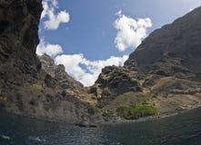 Ocean cliffs. Steep rocky volcanic cliffs near ocean Royalty Free Stock Photos