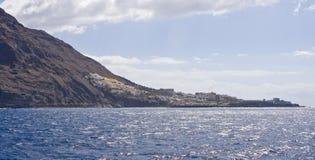 Ocean cliffs. Steep rocky volcanic cliffs near ocean Stock Image