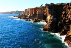 Ocean Cliffs and Sun Stock Photography