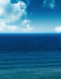 Ocean and clouds. Ocean scene with clouds and calm waters Stock Photos