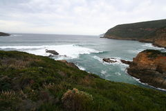 Ocean Coast. The rugged ocean coast of the far south-east of Tasmania near Remarkable Cave. Location: Maingon, Bay Tasmania, Australia stock photos