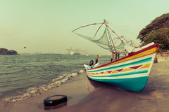 Ocean coast landscape with traditional Indian boat Stock Photos