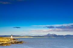 Ocean coast lighthouse in Port Charlotte, Scotland. United Kingdom Stock Images