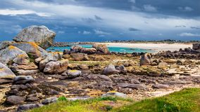 Ocean coast in Meneham village with granite rocks and boats, Kerlouan, Finistere, Brittany (Bretagne), France royalty free stock image