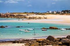 Ocean coast in Meneham village with granite rocks and boats, Ker. Louan, Finistere, Brittany (Bretagne), France Stock Images