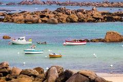 Ocean coast in Meneham village with granite rocks and boats, Ker. Louan, Finistere, Brittany (Bretagne), France Stock Photo