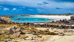Ocean coast in Meneham village with granite rocks and boats, Ker. Louan, Finistere, Brittany (Bretagne), France Royalty Free Stock Image