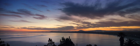 Ocean coast panorama with water and sunset sky Stock Photography