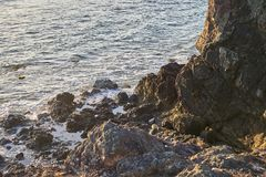Ocean coast with rocks and waves at sunrise. Beautiful seascape.  royalty free stock images