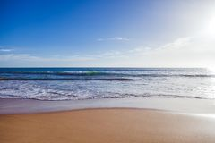 Ocean coast, sand beach and foamy waves, beautiful natural vacat. Ion background and texture Stock Photography
