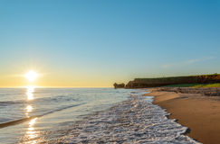 Ocean coast at the sunrise. (Central Coastal Drive, Prince Edward Island, Canada Royalty Free Stock Photos