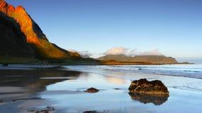 Ocean coast at sunrise, Norway. Ocean coast mountain panorama at sunrise - Norway Royalty Free Stock Photos
