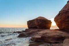 Ocean coast at the sunrise. Thunder Cove, Prince Edward Island, Canada Stock Photos