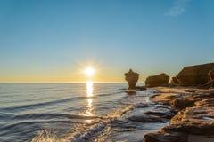 Ocean coast at the sunrise. (Thunder Cove, Prince Edward Island, Canada Stock Photography