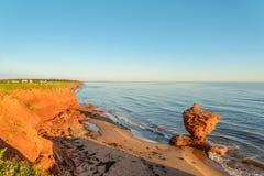 Ocean coast at the sunrise. (Thunder Cove, Prince Edward Island, Canada Royalty Free Stock Images