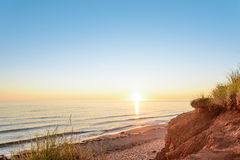 Ocean coast at the sunrise. (Thunder Cove, Prince Edward Island, Canada Stock Images