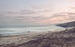 Ocean coast. After sunset, Instagram filter Royalty Free Stock Photo