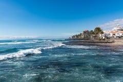 Ocean coast in the tourist resort Playa de las Americas, Tenerife island, Canary Islands, Spain. Winter sun travel stock image