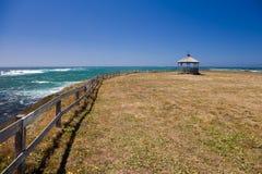 Ocean coastline landscape. With gazebo and fence Stock Images