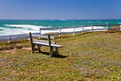 Ocean coastline landscape. With a bench and a fence Royalty Free Stock Images