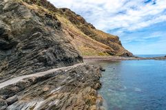 Ocean coastline with layered rock formations. And tourist path along the water edge. Second Valley, South Australia Royalty Free Stock Images